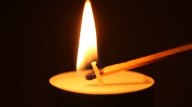 Lighting a candle with a match to get a romantic candlelight — Wideo stockowe
