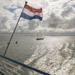 Wadden Sea with Dutch flag as seen from the ferry — Stock Photo #71319023