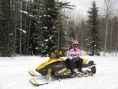 Woman on her snowmobile near Waskesiu in Saskatchewan. — Stock Photo