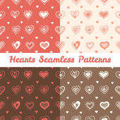 Vector soft hand drawn doodle hearts St Valentine Day seamless patterns set — Stock Vector