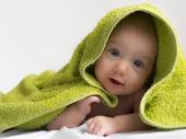 Baby in a towel after bathing — Stock Photo