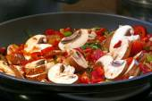 Stir fried vegetables in a black pan, close up — Stock Photo