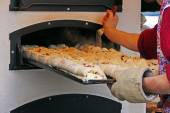 A tray of filled bread is pushed into the baking oven — Stock Photo