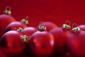 Group of red christmas balls, red background, copy space  — Stock Photo