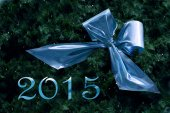 New year 2015, blue ribbon in fir branches with small fairy ligh — Stock Photo