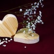 Wooden hearts and smal flowers on dark  background, valentine, m — Stock Photo #64016247