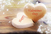 Two hearts on old wood, message happy valentines day — Stock Photo