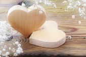 Two hearts of wood on wooden background, valentines or mothers d — Stock Photo