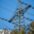 Power mast of a high voltage transmission line — Stock Photo #65043333