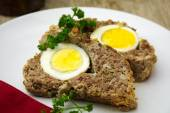 Easter meal, meatloaf bread with boiled eggs inside — Stock Photo