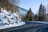 Curvy mountain road, winter landscape — Stock Photo
