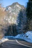 Curvy country road in the mountains, winter landscape — Stock Photo
