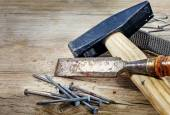 Old tools on a background from rustic wood — Stock Photo