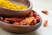 Asian spices, dried red chili and curcuma in wooden bowls — Stock Photo