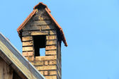 Chimney with roof against blue sky, copy space — Stock Photo