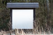 Blank information board in the nature with  space for your text — Stock Photo