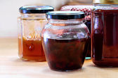 Jars with various homemade fruit jam — Stock Photo