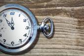 Pocket watch on old wood — Stock Photo