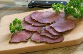Thin slices of cold beef coated with pepper — Stock Photo