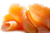Salmon pure in slices, close up on white — Stock Photo