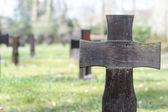 Dark wooden cross on a military cemetery — Zdjęcie stockowe