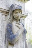 Femal statue as a grave stone — Stock Photo
