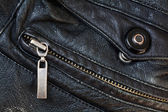 Zipper and press stud in old black leather — Stock Photo