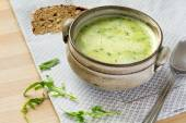 Cream soup from arugula  in a rustic bowl, some leaves, spoon an — Stock Photo