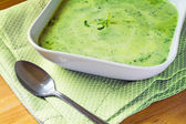 Green  soup from vegetables and herbs in a square shaped white p — Stock Photo
