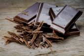 Dark chocolate on old rustic wood — Stock Photo