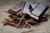 Dark chocolate on old rustic wood — Foto Stock