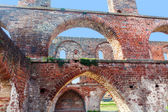 Arches of red brick in a ruin of a monastery building, Northern  — Zdjęcie stockowe