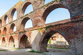 Arches in a ruin of a monastery building of red brick,  Northern — Zdjęcie stockowe