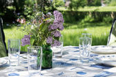 Decorated garden table to eat outside in the early summer — Stock Photo