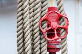 Red wheel, stop valve and ropes on a Tall Ship — Stock Photo