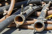 Rubber tubes with couplings on a construction site — Stock Photo