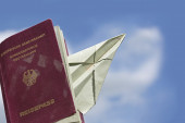 Sed passport from Germany with a paper airplane against the blue — Stock Photo
