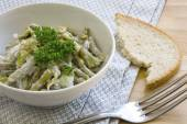 Salad of green beans with sour cream dressing and parsley garnis — Stock Photo