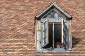 "Open window in an old dormer on a roof with historic ""beaver tai — Stock Photo"