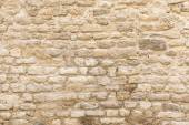 Background texture, wall of pale natural stone — Stock Photo