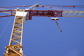 Part of a construction crane against the blue sky — Stock Photo