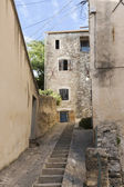 Narrow street with staircase in an old village in southern Europ — Stock Photo