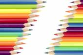 Colored pencils  in two diagonal rows isolated on a white backgr — Stock Photo