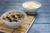 Mushroom vegetables and rice in bowls on a bamboo mat and rustic — Stock Photo