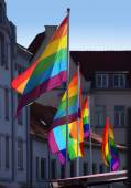 Glowing rainbow flags in the shady Old Town — Stock Photo
