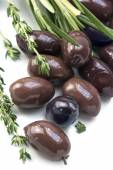 Kalamata, aromatic black olive from Greece with herbs on a white — Stock Photo