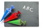 School cones on a  chartboard with message good luck — Stock Photo