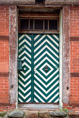 Front door with green and white pattern in an old house — Stock Photo