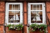 Mullioned windows in an old half timbered house — Stock Photo