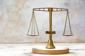 Vintage balance scales of justice made of brass — Stock Photo